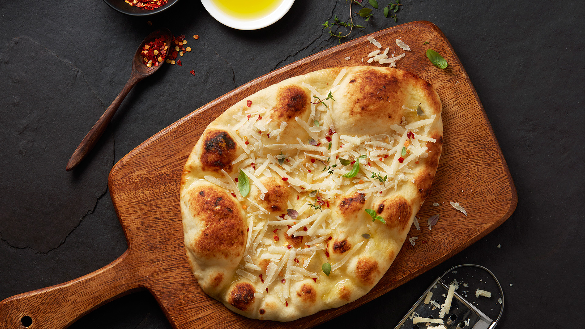 Warm Naan Topped With Olive Oil And Cheese Stonefire